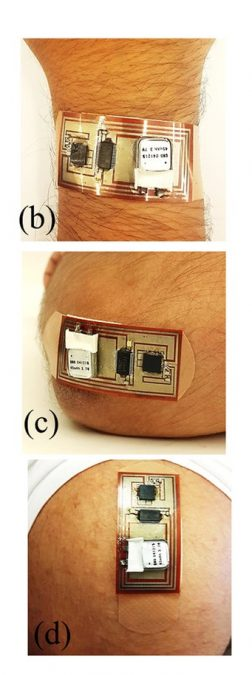 Wearablility tests. Smart bandage (with exposed electronics) worn on (b) wrist (c) elbow and (d) shoulder. Low Cost Inkjet Printed Smart Bandage for Wireless Monitoring of Chronic Wounds. Shamim et al 2016.